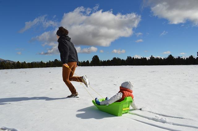 mom daughter sledding